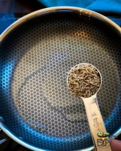 Cumin Seeds being added to hot oil