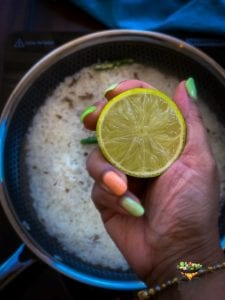 few lemon drops being added to jeera rice recipe
