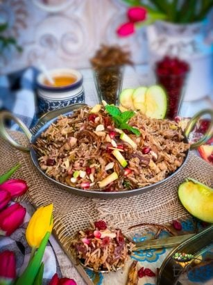 Kashmiri Pulao served in a Wok with accompaniments