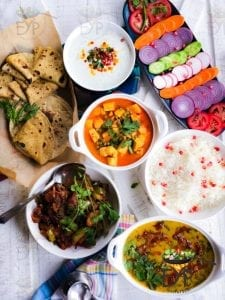 Matar Paneer & Palak Dal meal with aloo shimla mirch, cucumber raita and Roti