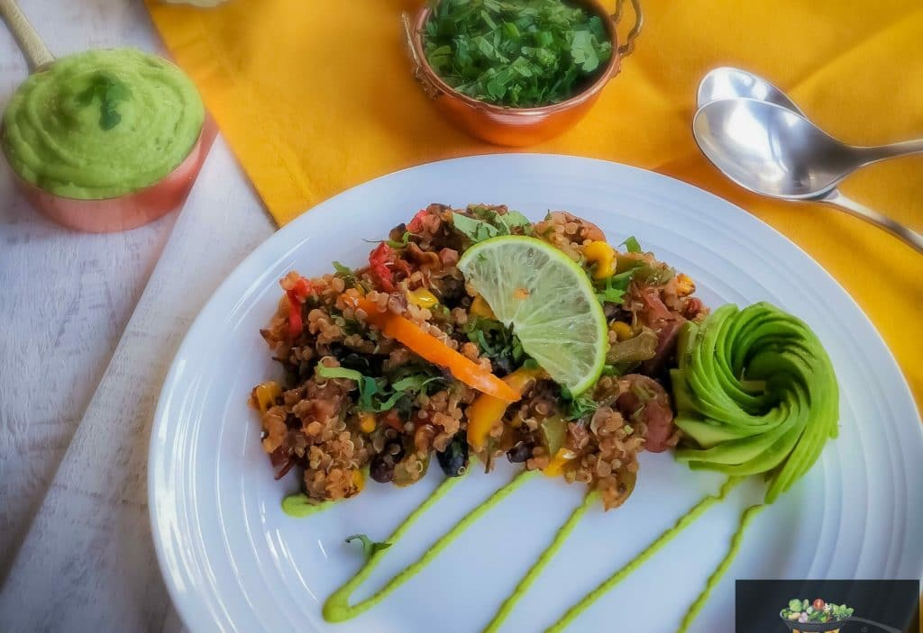 Mexican Quinoa served with guacamole and sliced avocado