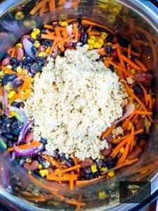 Adding raw washed and drained quinoa to mexican quinoa recipe