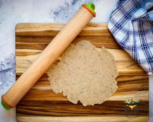 Adjustable rolling pin being used to roll namak para