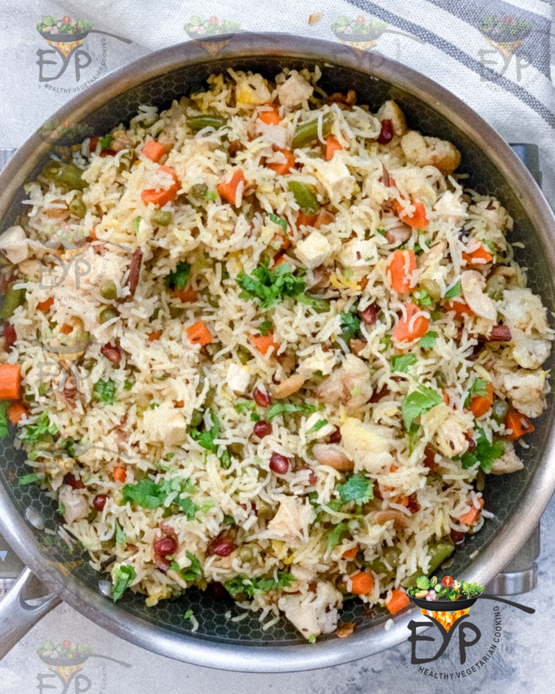 Navratan Pulao cooked in pan on stove top