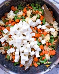 paneer added to vegetables getting cooked