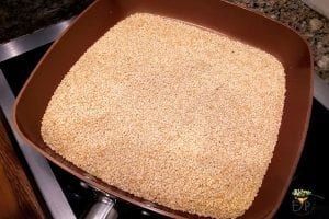 Sesame seeds being roasted in a pan