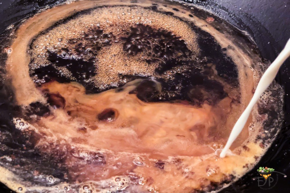 Sugar syrup being made in a wok for burfi
