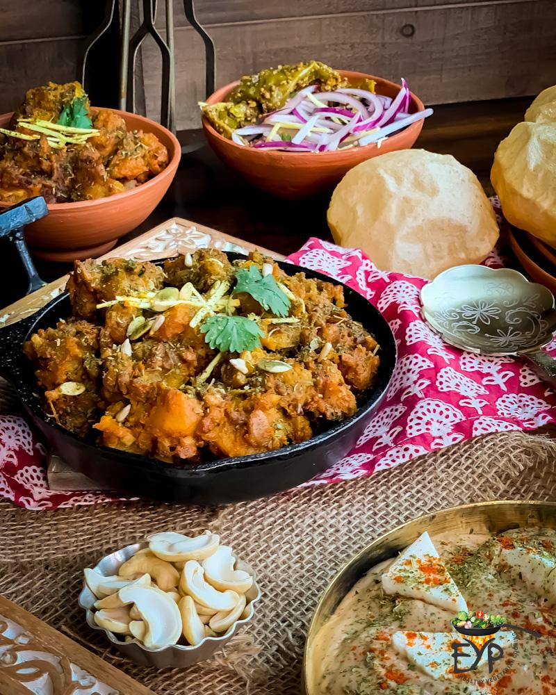 Sweet and Sour Pumpkin Curry – Khatta Meetha Kaddu served with Puri