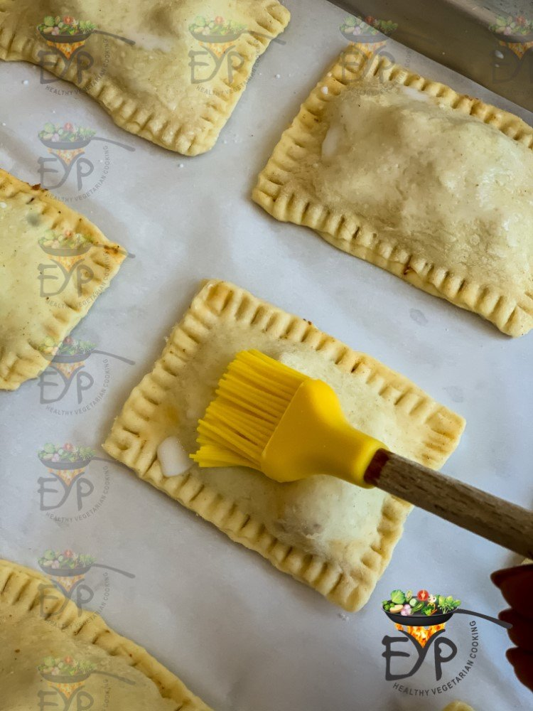 brushing curry puff with milk and butter