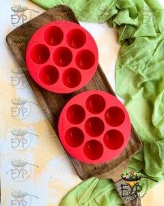 oiled eggbite molds prepared for steaming