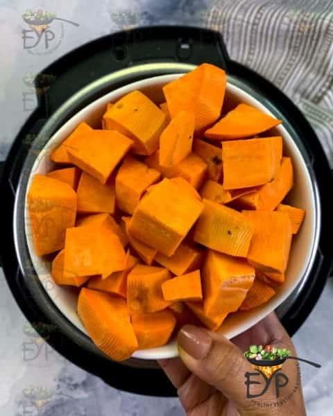 Adding cubed sweet potato