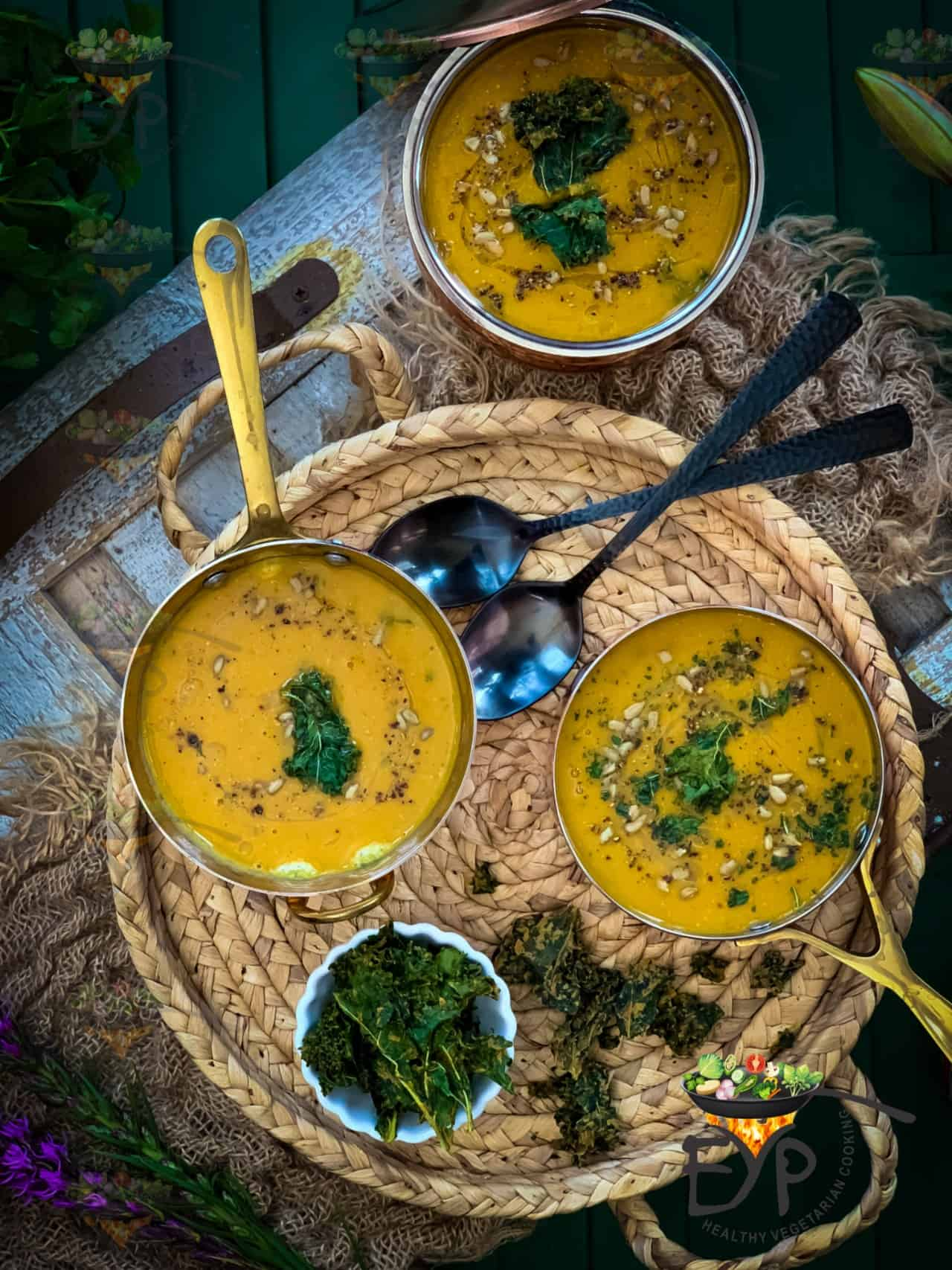 Lentil and Sweet potato soup garnished with kale leaves, black pepper and sun flower seeds