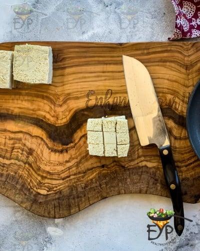 Tofu being chopped