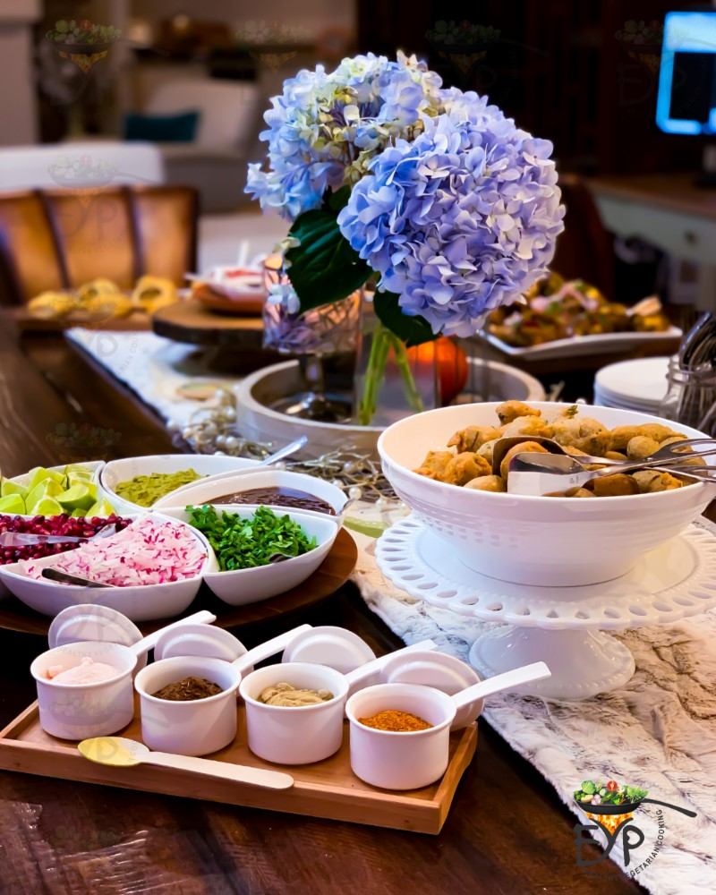 Thanksgiving appetizer table with beautiful flower centerpiece