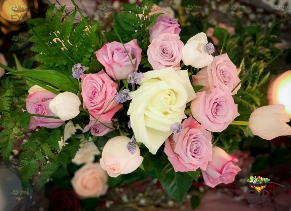 pastel color roses in floral centerpiece for an understated Valentine's Day tablescape