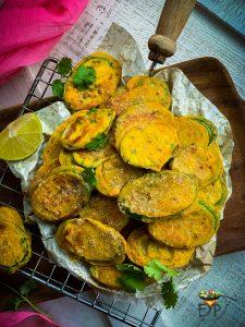 zucchini fritters on a mesh for cooling